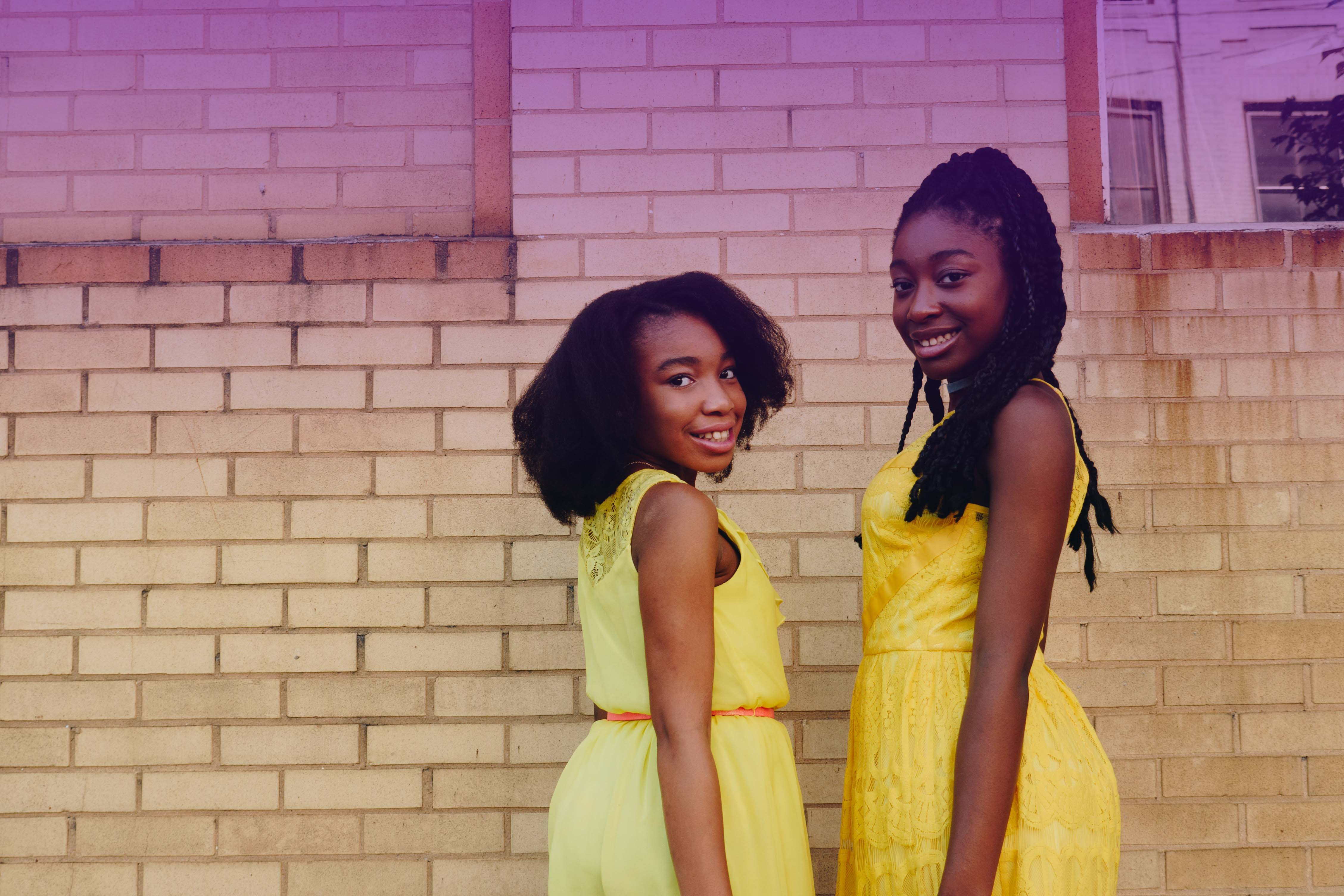 girls in yellow with purple